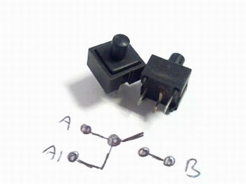 Pushbutton momentary switch black round knob Radiohm ST1034D